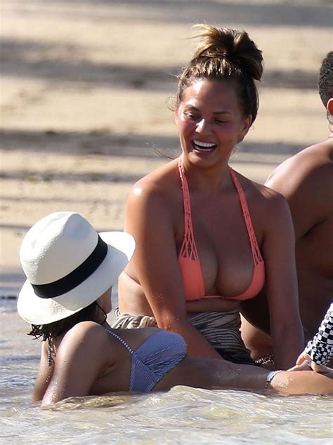 John Legend and Chrissy Teigen on holiday with actress